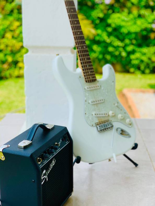 Beautiful White Fender Electric Guitar & Amp with a range of Accessories