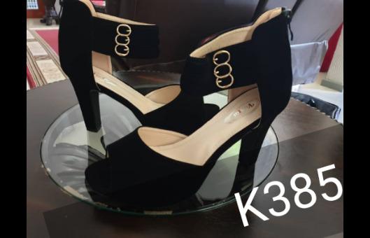 Ladies Black open toed heels.