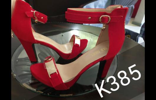 Ladies red open toed heels.
